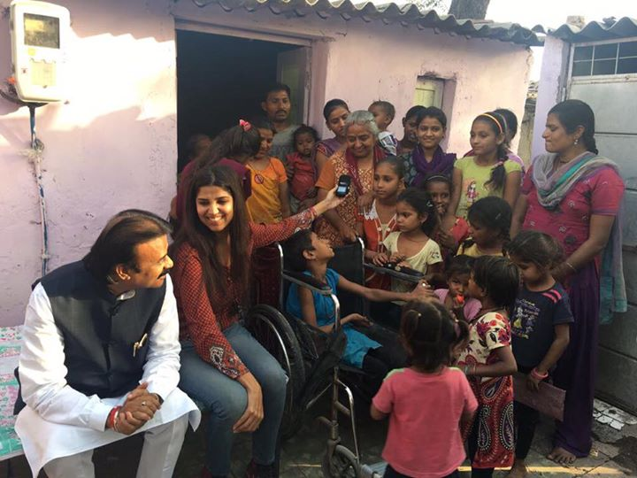 Any questions you have on #BajaoForACause #EkDevakiAisiBhi I shall answer them on on a Facebook live this evening at 7:30pm.... See You...  Here is a photograph of our Mayor's visit with me to Devaki's chaali at vatva... the girl on the wheelchair wearing blue is the other devaki...